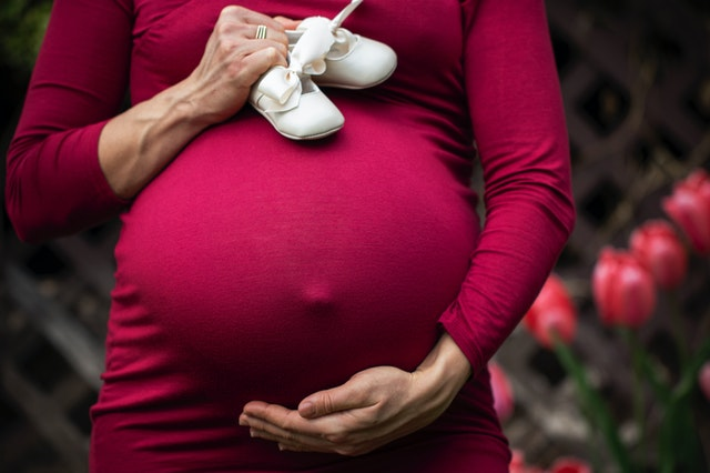 When does your stomach become hard during pregnancy